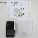 NETGEAR WN3000RP Universal WiFi Range Extender, contenuto della scatola e raffronto dimensioni con un iPhone 3GS - TheAppleLounge.com