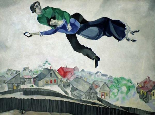 Originale reinterpretazione di Sopra la città (Chagall, 1914-18). La donna pubblica su Facebook la notizia del suo rapimento in tempo reale.